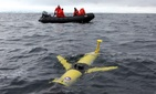 A Rutgers/Webb-SLOCUM glider being released by scientists near Antarctica
