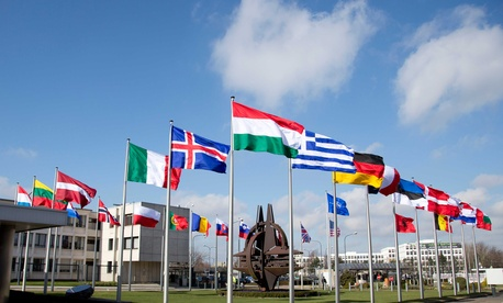 Flags flutter in the wind at NATO headquarters in Brussels, Belgium