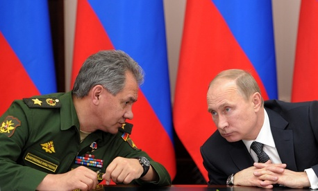 Russian President Vladimir Putin, right, and Defense Minister Sergei Shoigu attend a meeting while visiting the airborne troops school in the city of Ryazan on November 15, 2013.