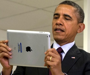 Barack Obama holds an iPad at an event at a Maryland school in February.