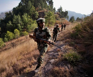 An Indian soldier marches along the Line of Control, the contested border between India and Pakistan