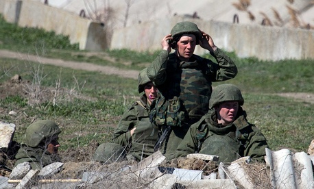 Pro-Russian troops standing in position in Feodosia, Crimea.