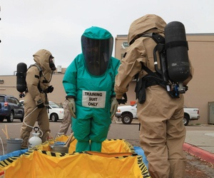 Marines with the Marine Wing Headquarters Squadron conduct decontamination procedures during a training exercise