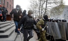 Pro-Russian activists leaving the office of the regional prosecutor in Donetsk, Ukraine