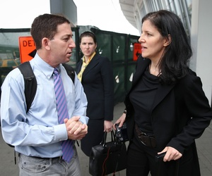 Glenn Greenwald and Laura Poitras after arriving at New York's John F. Kennedy International Airport