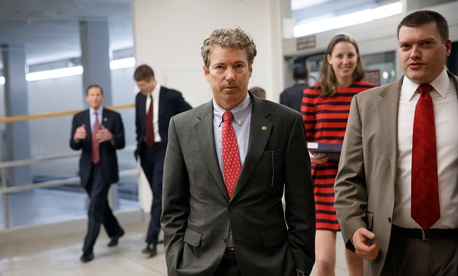 Sen. Rand Paul, R-Ky, heads to the Senate floor to advance a bill supporting aid to Ukraine
