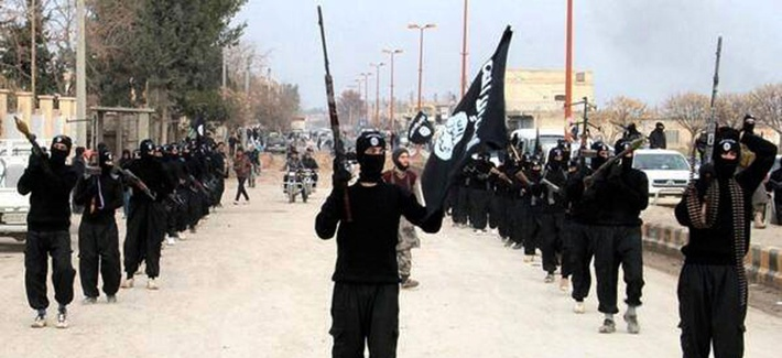 Fighters with the al-Qaeda linked Islamic State of Iraq and the Levant march through Raqqa, Syria