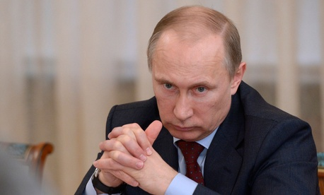 Russian president Vladimir Putin meets with members of the Russian Federation Council in a suburb of Moscow