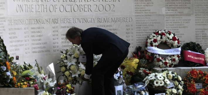 British Minister of State at the Foreign Office Hugo Swire places a wreath at the memorial in London to mark the 10th anniversary of the terror bombings in Bali, Indonesia. Suicide bombers killed 202 people at popular nightspots in 2002.