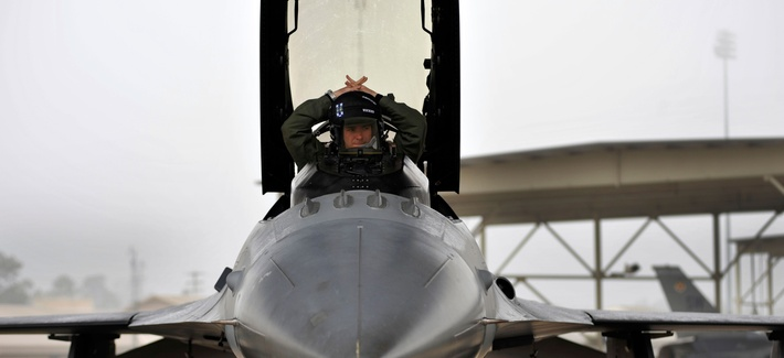 A U.S. Air Force Captain with the 55th Fighter Squadron prepares his cockpit in his F-16 prior to takeoff from Shaw Air Force Base, South Carolina