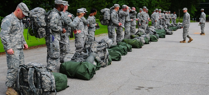 Officer Candidate School cadre greet new candidates arriving to Fort McClellan, Ala., July 19, 2013.