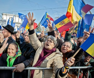 Moldovan women change pro-European Union slogans in Chisinau, Moldova, last November.