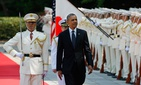 President Barack Obama reviews an honor guard during a welcome ceremony at the Imperial Palace in Tokyo, T
