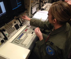 A Minuteman 3 missile launch officer at the console of a launch simulator used for training at F. E. Warren Air Force Base, Wyo., on Jan. 9, 2014.