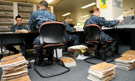 Navy personnel specialists convert Enlisted Field Service Records to electronic files at the Naval Medical Center San Diego, July 28, 2010.