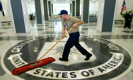 A workman slides a dust mop over the floor at the Central Intelligence Agency headquarters in Langley, Va., March 3, 2005.