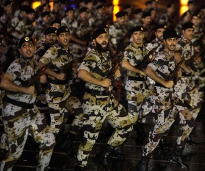Saudi military soldiers march during a military parade marking the Hajj in October 2013