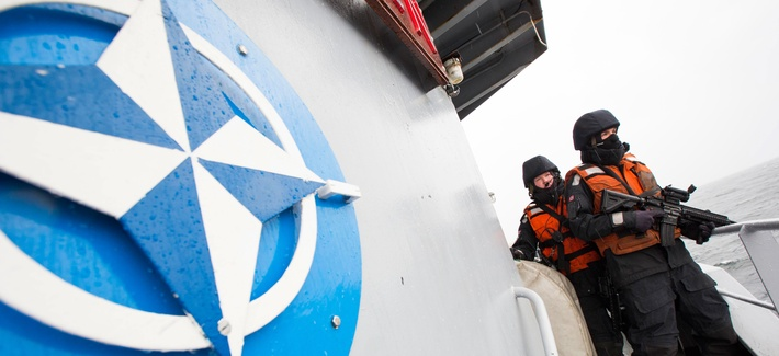 Two Norwegian sailors onboard the Norwegian support vessel Valkyrien pose for photographers during a deployment in the Baltic Sea on April 23, 2014.
