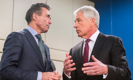 Defense Secretary Chuck Hagel talks with NATO Secretary General Anders Fogh Rasmussen ahead of a meeting of NATO defense ministers and NATO-Ukraine Commission at NATO headquarters in Brussels on Feb. 27, 2014.