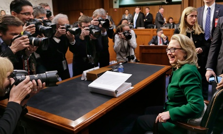 Former Secretary of State Hillary Rodham prepares to leave after testifying on before the Senate Foreign Relations Committee in Washington, Jan. 23, 2013.