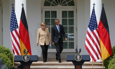 President Barack Obama and German Chancellor Angela Merkel arrive for a joint news conference in the Rose Garden at the White House in Washington, May 2, 2014.