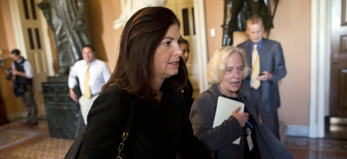 Sen. Kelly Ayotte, R-N.H, walks to a meeting with Senate Minority Leader Mitch McConnell, R-Ky., on October 14, 2013