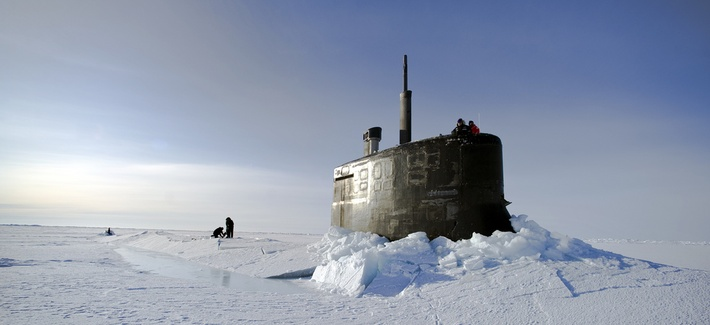 Sailors clear ice outside the USS Connecticut during Ice Exercise 2011