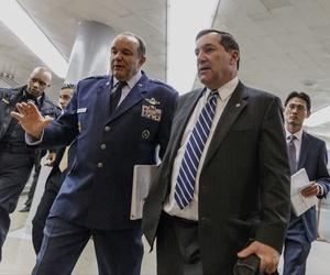 Sen. Joe Donnelly, D-Ind., walks with U.S. European Command chief Gen. Philip Breedlove on Capitol Hill.