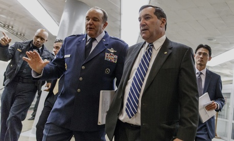 Sen. Joe Donnelly, D-Ind., walks with U.S. European Command chief Gen. Philip Breedlove on Capitol Hill.
