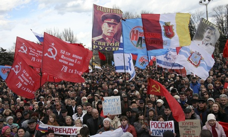 Protestors display Soviet-era flags and other posters during a demonstration in Odessa, Crimea.