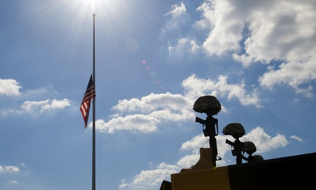 A flag at Fort Hood rests at half mast during a memorial ceremony honoring the victims of the November 5, 2009 shooting