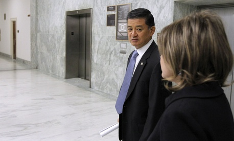 Veterans Affairs Secretary Eric Shinseki waits for an elevator at the Rayburn House Office Building on Capitol Hill.