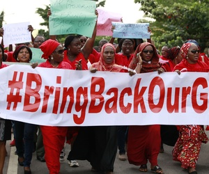 Women in Abuja, Nigeria, attend a demonstration to call on the Nigerian government to rescue the missing Chibok schoolgirls.