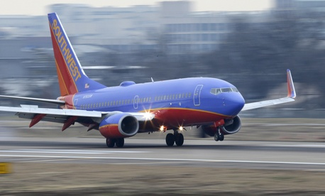 A Southwest Airlines jet lands at Love Field in Dallas, Feb. 3, 2014.