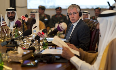 Defense Secretary Chuck Hagel listens to his Saudi counterpart Salman bin Abdulaziz Al Saud at the Gulf Cooperation Council Defense Ministerial in Jeddah, Saudi Arabia, May 14, 2014.