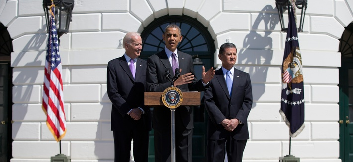 President Barack Obama, flanked by Veterans Affairs Secretary Eric Shinseki, right, and Vice President Joe Biden, welcome the Wounded Warrior Project's Soldier Ride to the South Lawn of the White House on April 17, 2014.