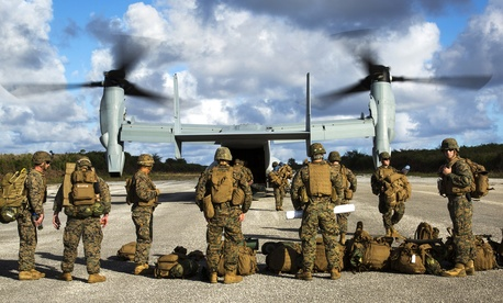 Troops with the Marine Air-Ground Task Force disembark from an MV-22B Osprey at Baker runway in the Philippines on December 9, 2013.