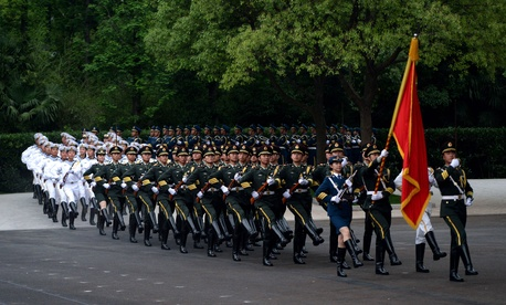 Members of a Chinese honor guard prepare for the arrival of Chinese President Xi Jinping for a conference in Kazakhstan on May 19, 2014.
