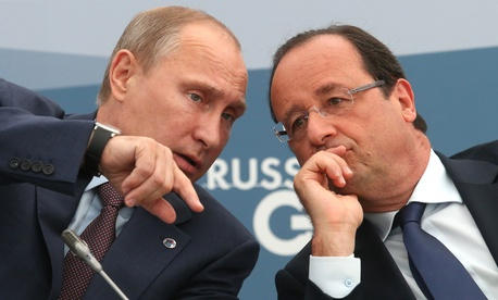 French President Francois Hollande, right, speaks with Russia's President Vladimir Putin during a meeting with G20 leaders in St. Petersburg, Russia on Sept. 6, 2013.