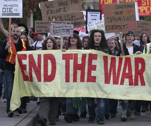 Several hundred demonstrators march in downtown Seattle to protest the war in Afghanistan in October 2011 ahead of the 10-year anniversary of the start of the war.
