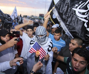 Supporters of the al-Qaeda-linked militant group Ansar al-Shariah burn an American flag in Benghazi, Libya in October.