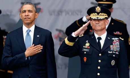 President Barack Obama and Lt. Gen. Robert Caslen Jr., superintendent at the U.S. Military Academy, stand for the national anthem during a graduation and commissioning ceremony at the academy, Wednesday, May 28, 2014, in West Point, N.Y.