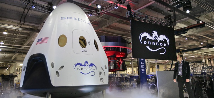 Elon Musk, right, unveils the SpaceX Dragon V2 spacecraft Thursday, May 29, 2014, in Hawthorne, Calif.