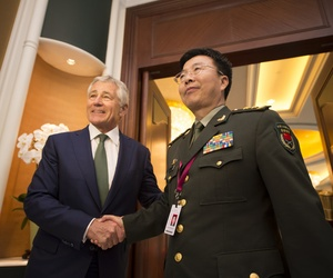 Defense Secretary Chuck Hagel meets with Lt. Gen. Wang Guanzhong, the deputy chief of the General Staff of China at the Shangri-La Dialogue in Singapore on Saturday.