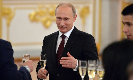 Russian President Vladimir Putin toasts the victory of the Russian ice hockey team at the Ice Hockey World Championship last month.