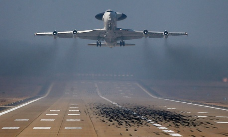 A NATO AWACS plane takes off the NATO Airbase in Geilenkirchen, Germany on March 12, 2014. Russia's readiness to use military force in Ukraine has been a wake-up call for many European countries.