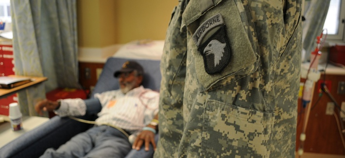 An Army captain visits a Vietnam War veteran at a VA hospital in Nashville, Tn., on November 5, 2012.