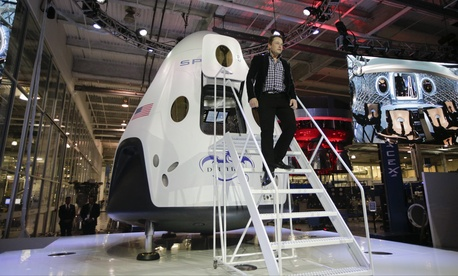SpaceX CEO Elon Musk introduces the Dragon V2 spaceship at company headquarters in Hawthorne, Calif., on May 29, 2014.