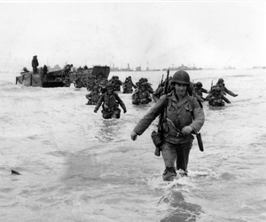 U.S. infantrymen wade through the surf as they land at Normandy, France on June 6, 1944.