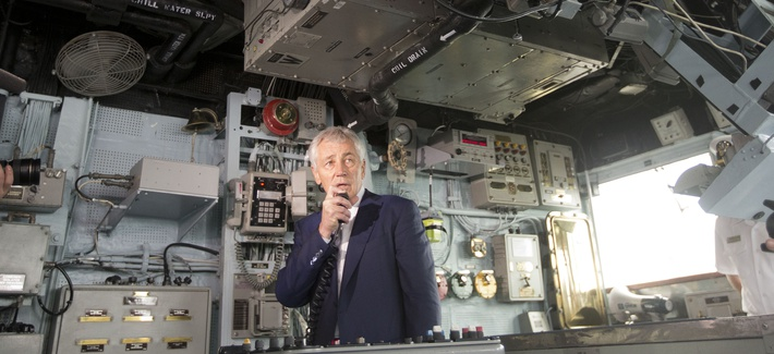 Defense Secretary Chuck Hagel uses the internal communications system of the USS Vella Gulf to address crew members on June 5, 2014.